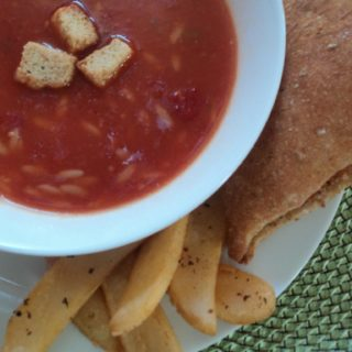 Tomato and orzo soup with fries and a sandwich