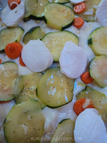 Spread some bechamel to next layer and add the zucchini, carrot and bocconcini