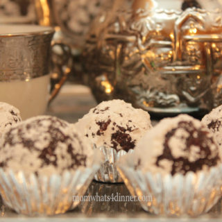 coconut date balls in icing sugar