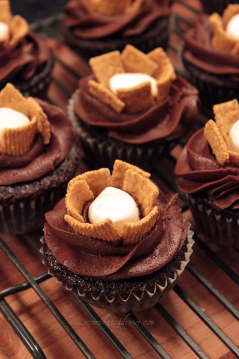 I was running out of icing, so we came up with these s'more cupcakes! My daughter told me to stuff them with a marshmallow, then I took the icing and made a swirl around it, and took some Golden Graham cereal and make a flower or 'fire' for a campfire s'more! I think they turned out cute!